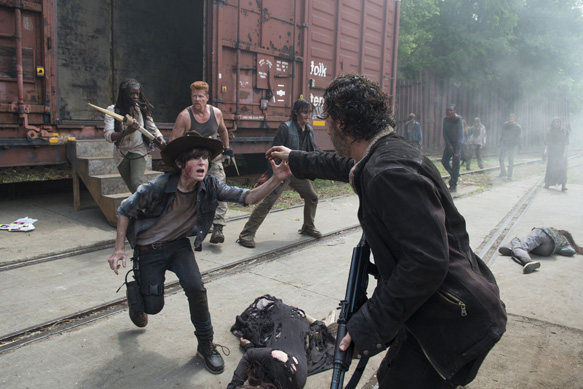 Danai Gurira as Michonne,  Michael Cudlitz as Abraham, Norman Reedus as Daryl Dixon, Chandler Riggs as Carl Grimes and Andrew Lincoln as Rick Grimes - The Walking Dead _ Season 5, Episode 1 - Photo Credit: Gene Page/AMC