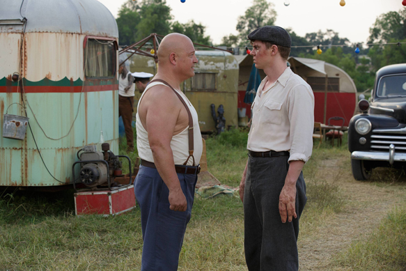 "AMERICAN HORROR STORY: FREAK SHOW ""Massacres and Matinees""- Episode 402 (Airs Wednesday, October 15, 10:00 PM e/p) --Pictured: (L-R) Michael Chiklis as Dell Toledo, Evan Peters as Jimmy Darling. CR: Michele K. Short/FX"