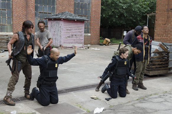 Norman Reedus as Daryl Dixon, Andrew Lincoln as Rick Grimes, Maximiliano Hernandez as Lamson, Teri Wyble as Shepherd, Chad Coleman as Tyreese and Tyler James Williams as Noah - The Walking Dead _ Season 5, Episode 7 - Photo Credit: Gene Page/AMC