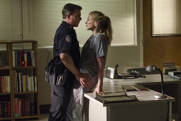Cullen Moss as Officer Gorman and Emily Kinney as Beth Greene - The Walking Dead _ Season 5, Episode 4 - Photo Credit: Gene Page/AMC