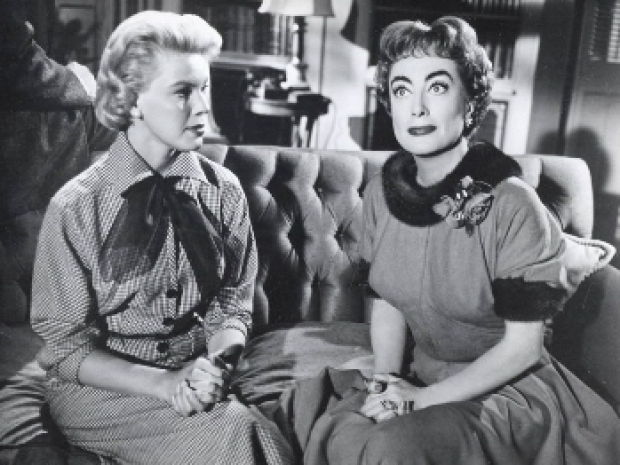 L to R Betsy Palmer and Joan Collins in Queen Bee (1955)