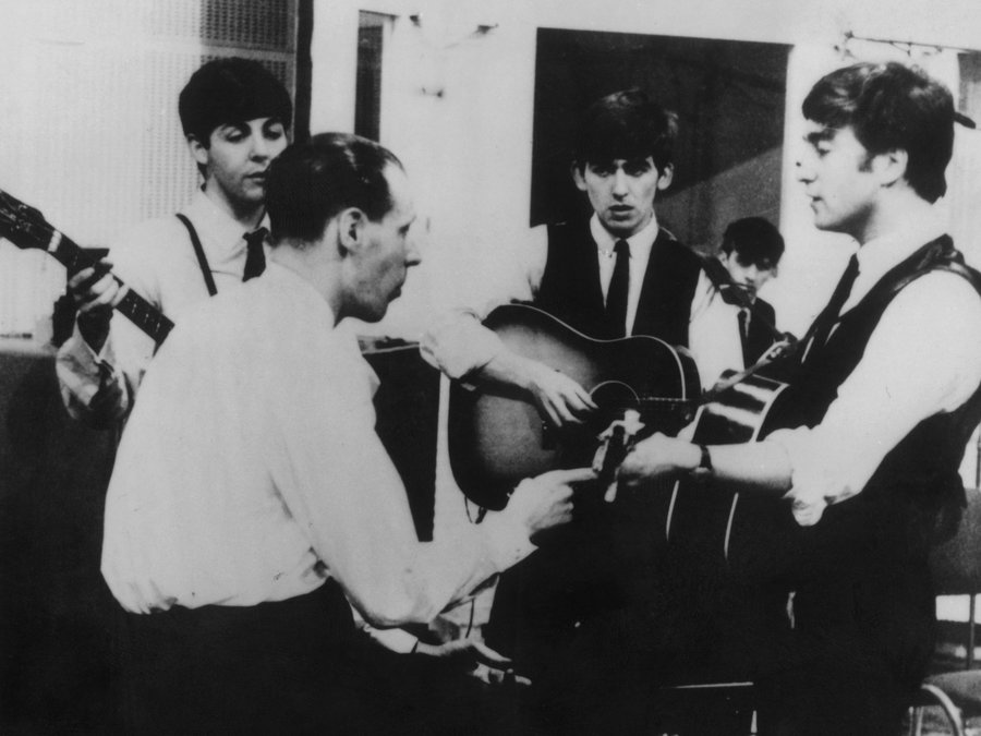 Producer George Martin in a recording session with The Beatles. Keystone/Getty Images
