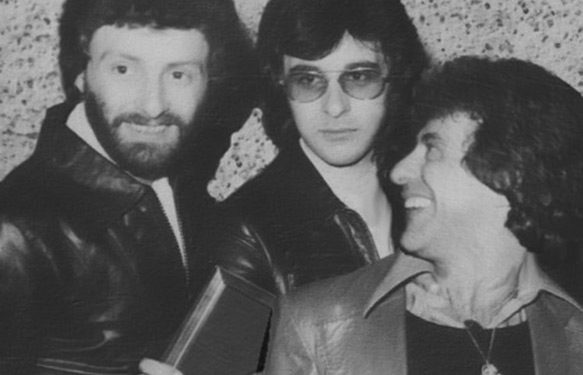 Receiving a Gold Record award with Frankie Valli in London, 1977